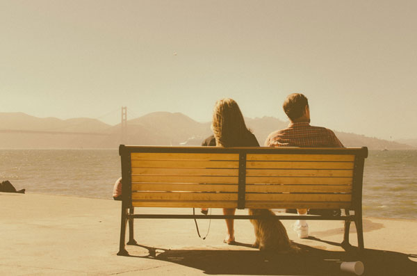 Couple sitting on a bench.